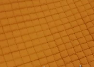 Tejido acolchado color mostaza