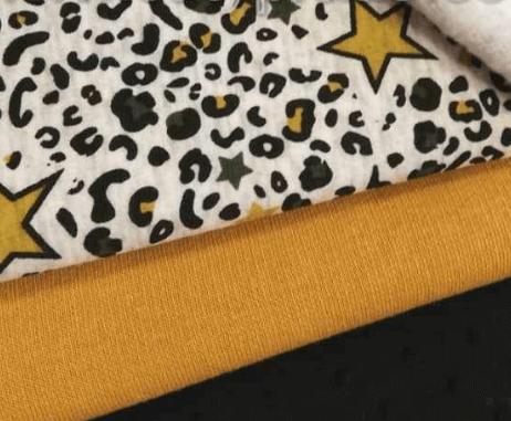 Tejido estampado animal print en tonos mostaza