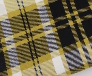 Tejido a cuadros estilo tartán escocés en tonos mostaza
