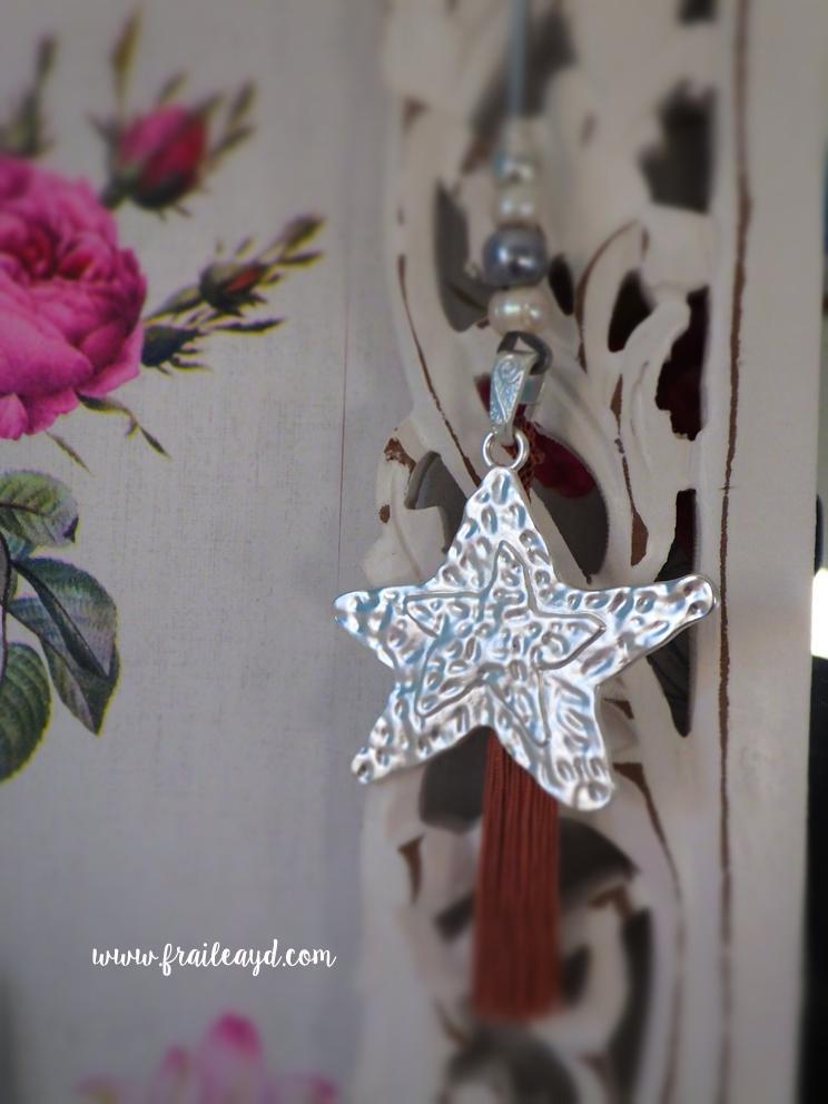 Colgante estrella plata con borla