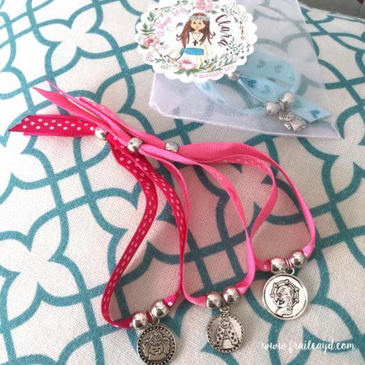 Pack 25 pulseras de cinta con medalla en bolsa de gasa con etiqueta personalizada