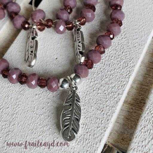 Pulsera cristal rosa y pluma plata