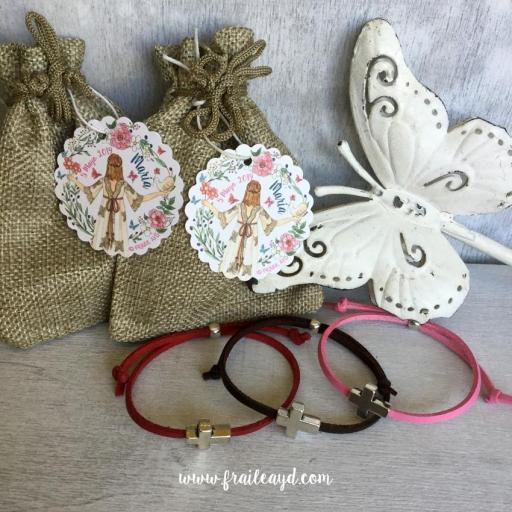 Pack 25 pulseras antelina cruz pasante en bolsa de lino/saco con etiqueta personalizada [1]
