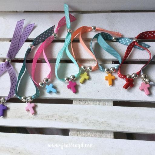 Pack 5 pulseras cinta topos con cruz colores [1]