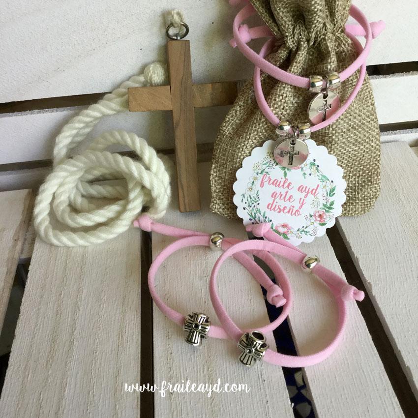 Pulseras elásticas rosas con cruz