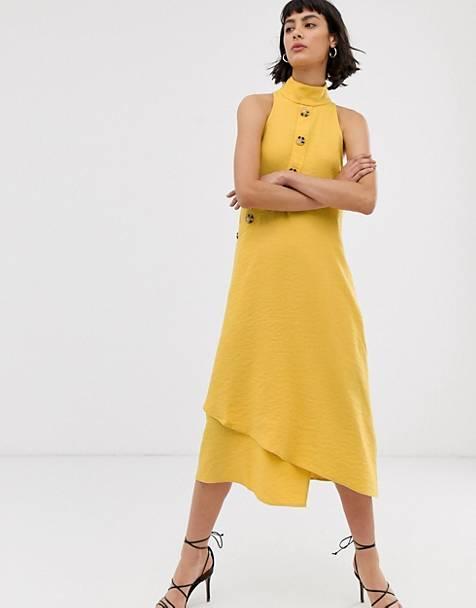 Vestido midi sin mangas con diseño asimétrico abotonado