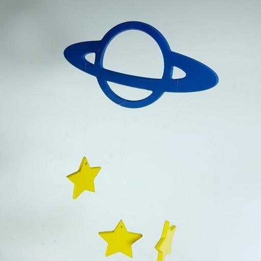 móvil planeta con estrellas