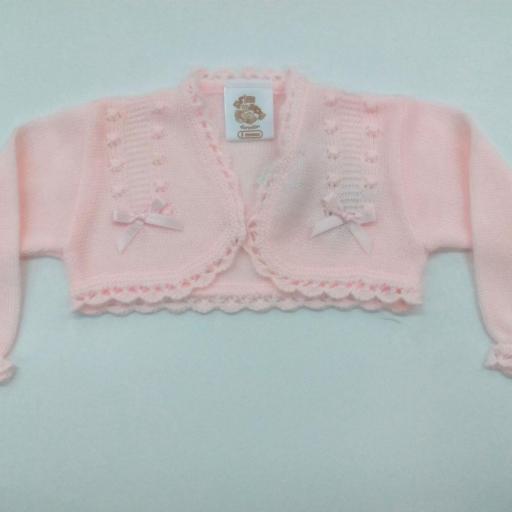 Chaqueta de niña rosa con lazos en perle.