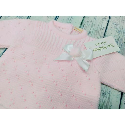 Chaqueta con polaina de bebé en rosa de Tony Bambino. [1]