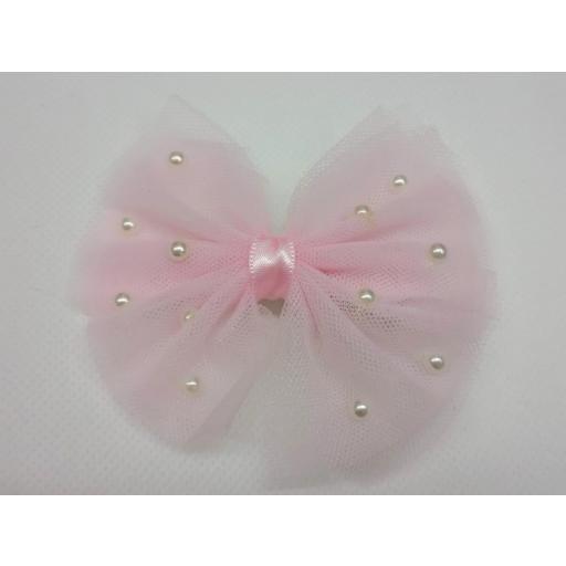 Lazo de pelo de tul rosa con perlitas de Inca Hair. [1]