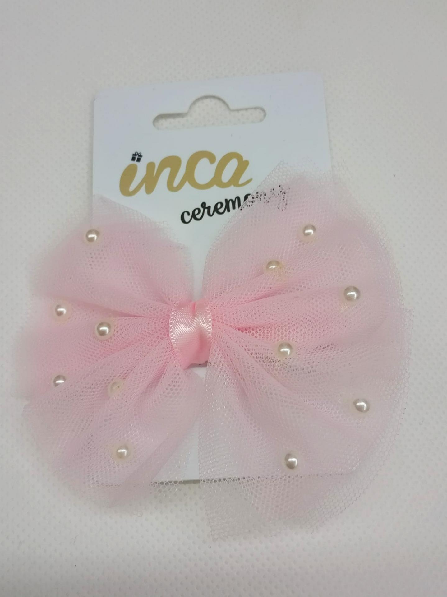 Lazo de pelo de tul rosa con perlitas de Inca Hair.