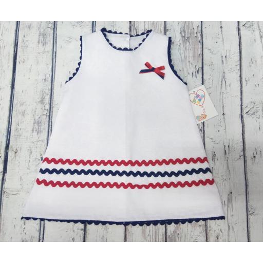 Vestido de bebé de piqué marinero de Prim Baby.