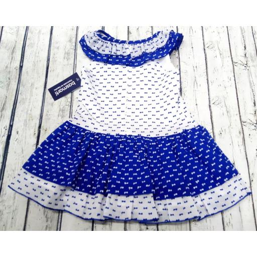Vestido de niña en azulón de Basmarti. [1]