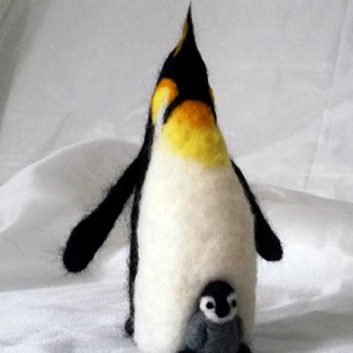 Pingüino Emperador con su polluelo