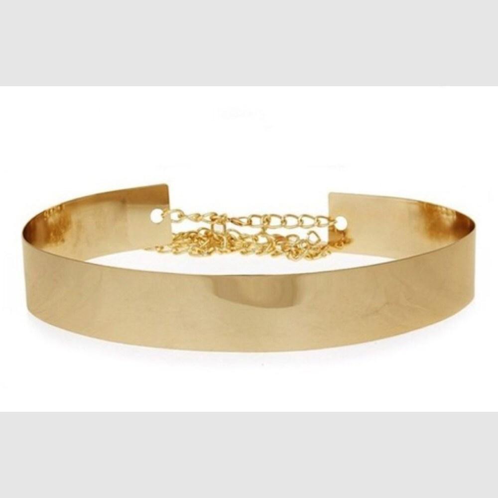 Cinturón metálico dorado