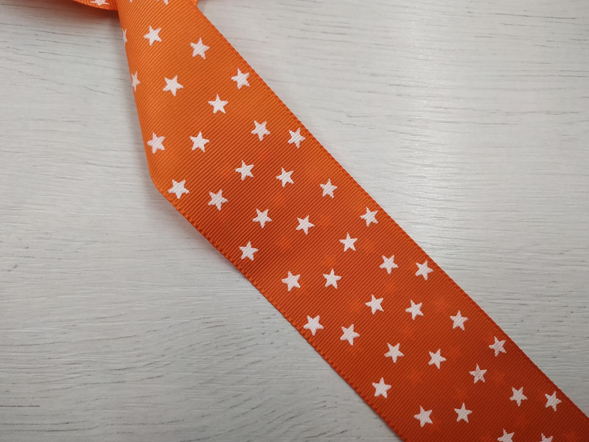 Cinta falla naranja con estrellas blancas
