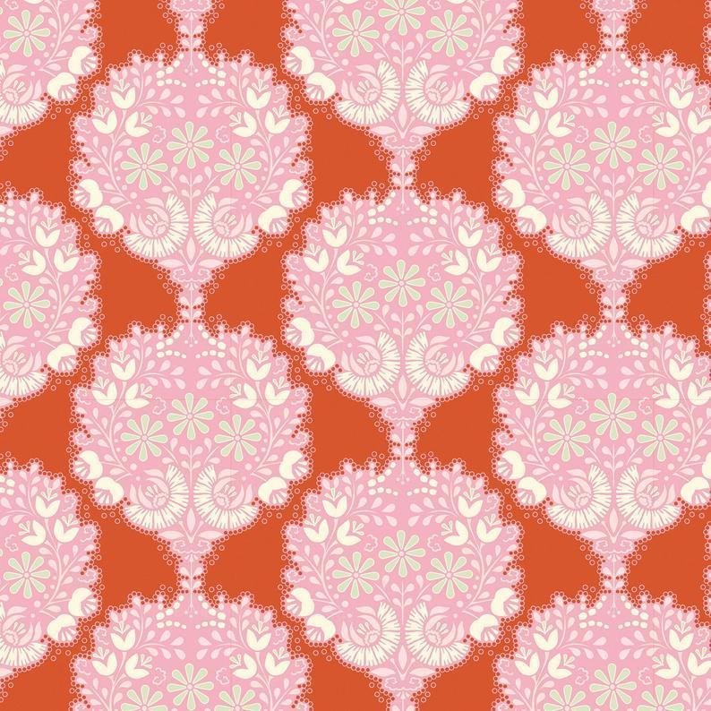 Tela patchwork de fondo naranja con dibujos rosas Tilda
