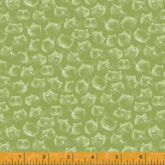 Tela patchwork verde con cabezas de gatos