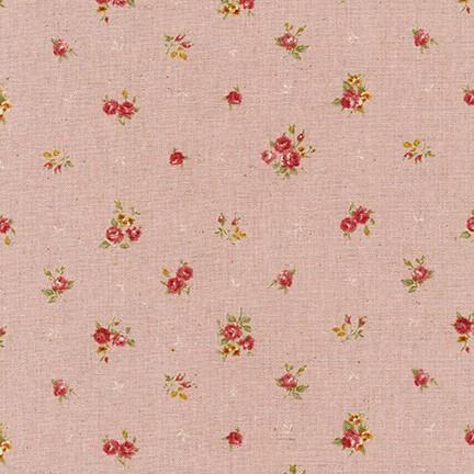 Tela patchwork de fondo rosa pastel con flores rosas