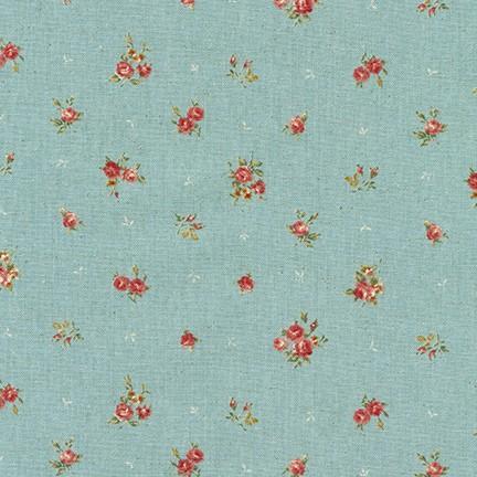 Tela patchwork de fondo azul claro con flores rosas
