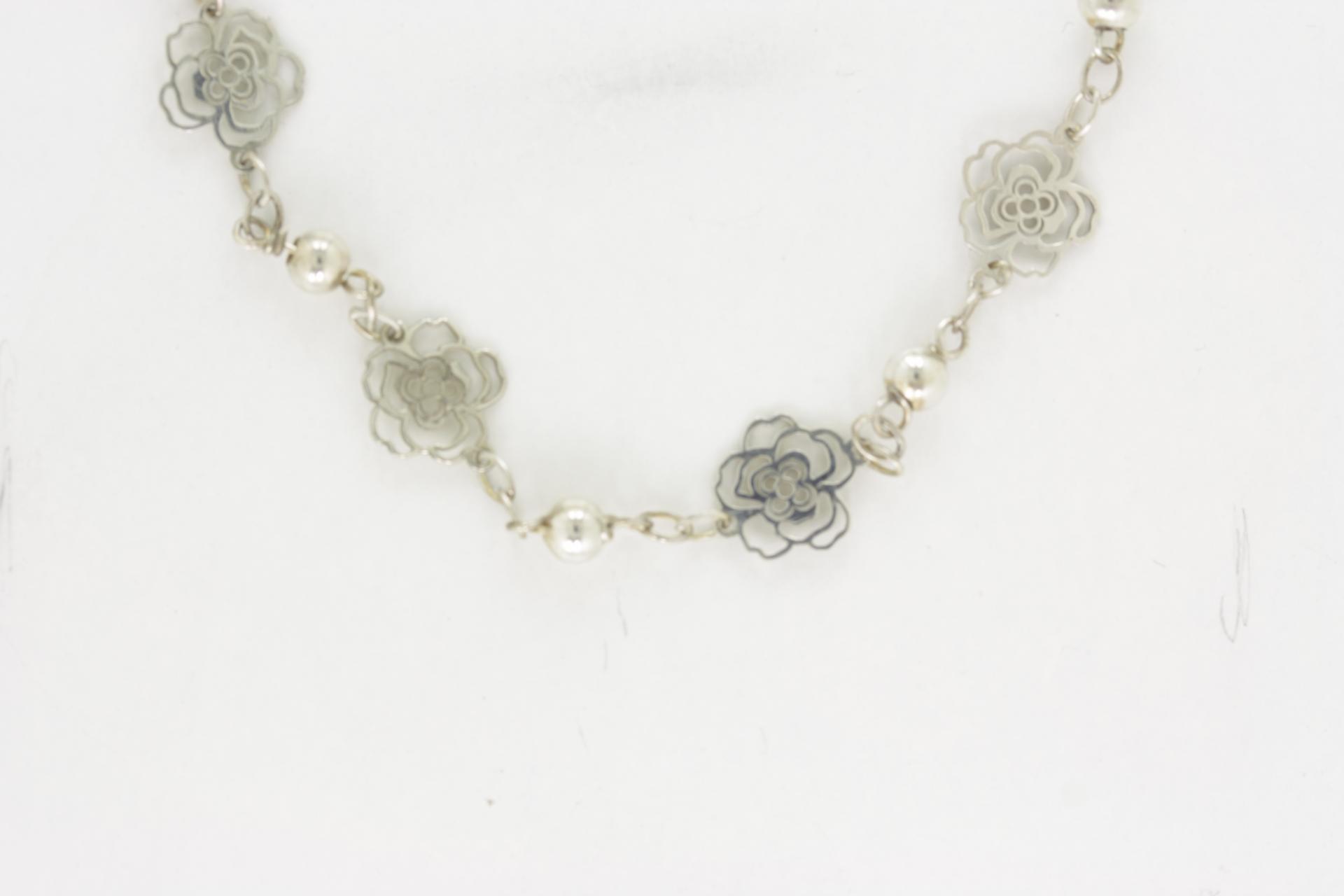 Pulsera rosas en plata