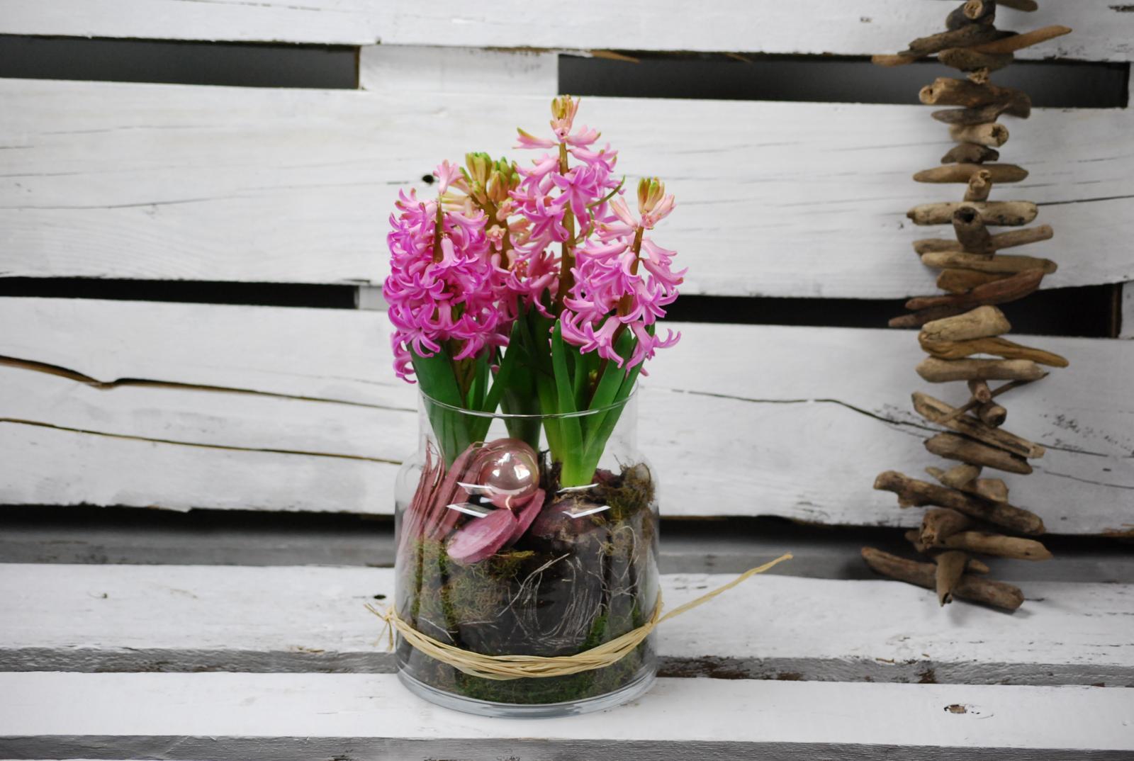 Composición de flor temporada en base de musgo