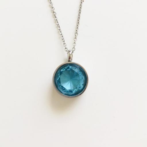 Colgante de. acero con cristal azul turquesa transparente