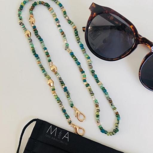 Cuelga mascarillas o gafas en tonos verde y dorado [1]