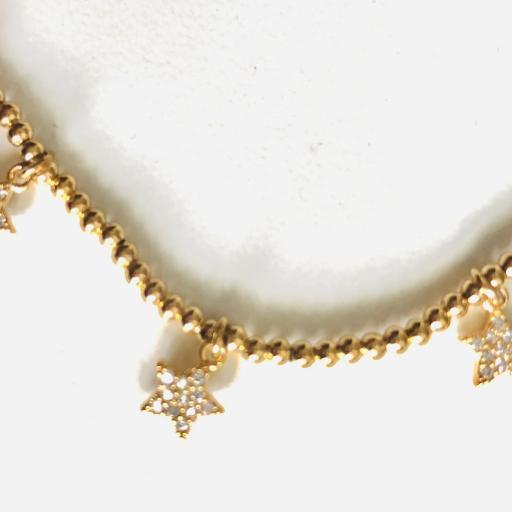 Pulsera elástica de acero dorado con bolitas y estrellas [1]