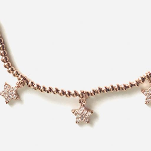 Pulsera elástica de acero rosado con bolitas y estrellas [1]