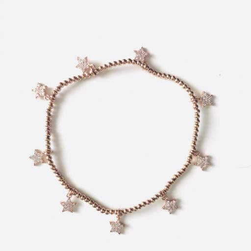 Pulsera elástica de acero rosado con bolitas y estrellas