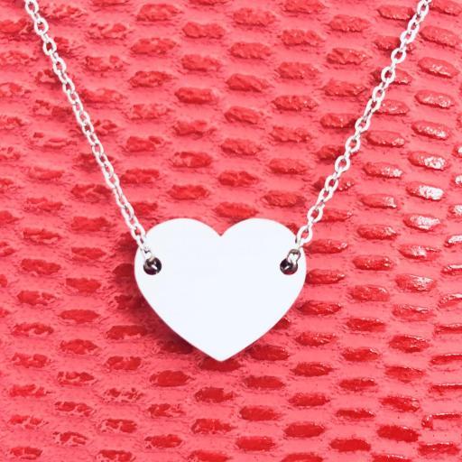 Colgante corazón de acero plateado [3]