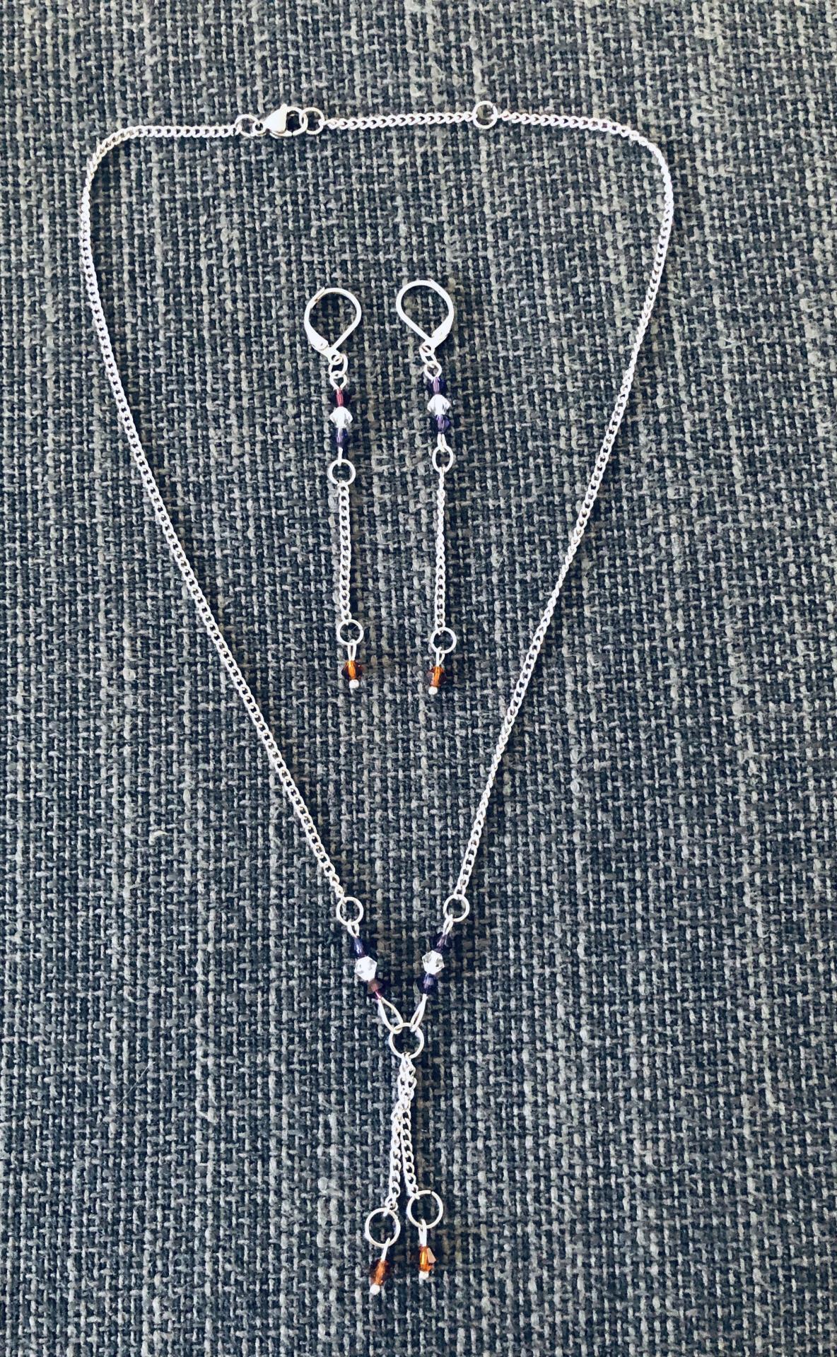 Conjunto de pendientes y collar con cristales Swarovski morados y cobrizos