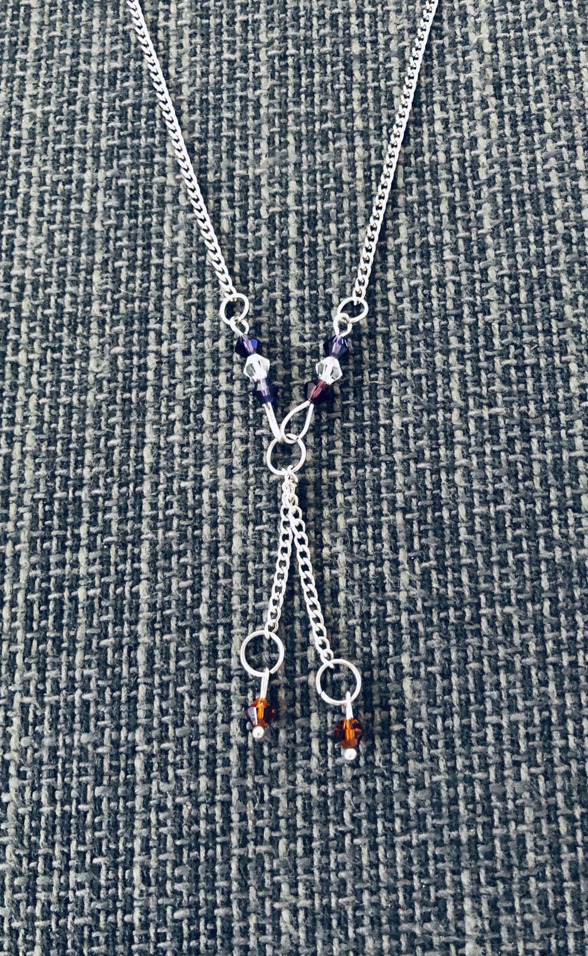 Collar de acero y cristales Swarovski  en color morado y cobre