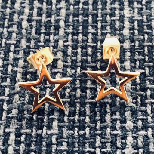 Conjunto  pendientes y colgante estrella dorada de acero [1]