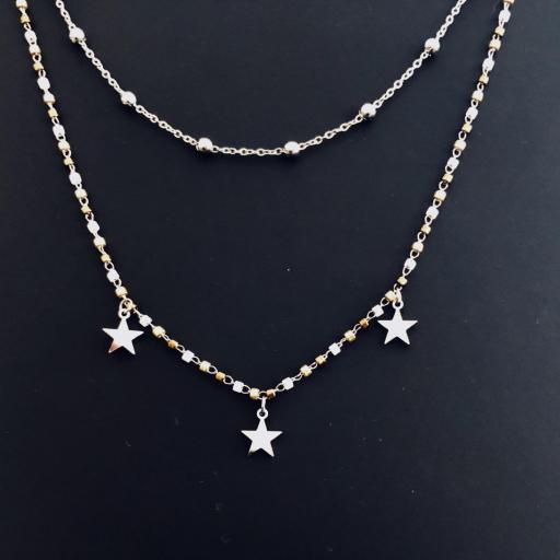 Collar doble  con estrellas plateadas y tonos cobre dorados