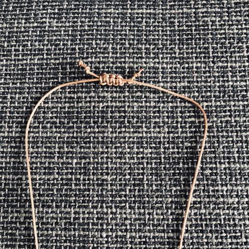 Collar marrón y dorado con cuerno cerámico [2]