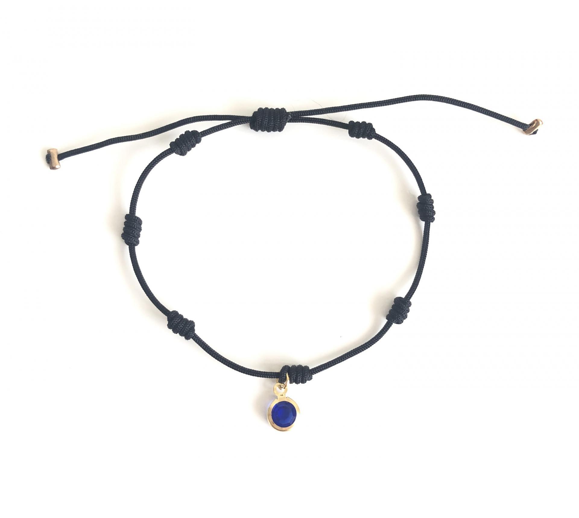 Pulsera negra de 7 nudos con cristal azul marino