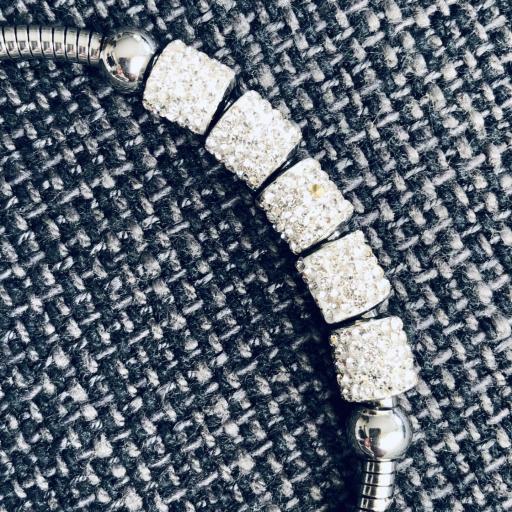 Pulsera de hilo flexible con charms plateados [1]