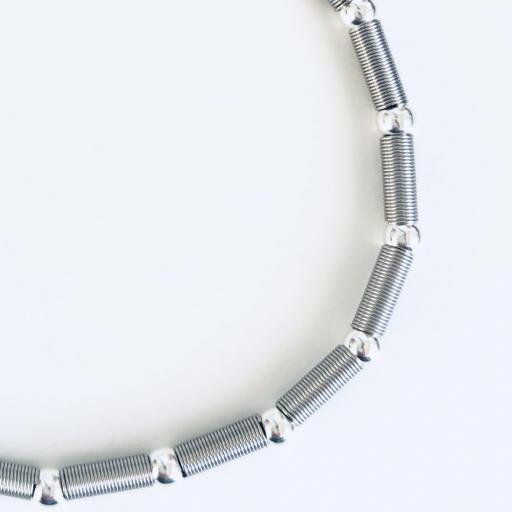 Pulsera elástica de plata  y acero con bolas bañadas de rodio  [1]