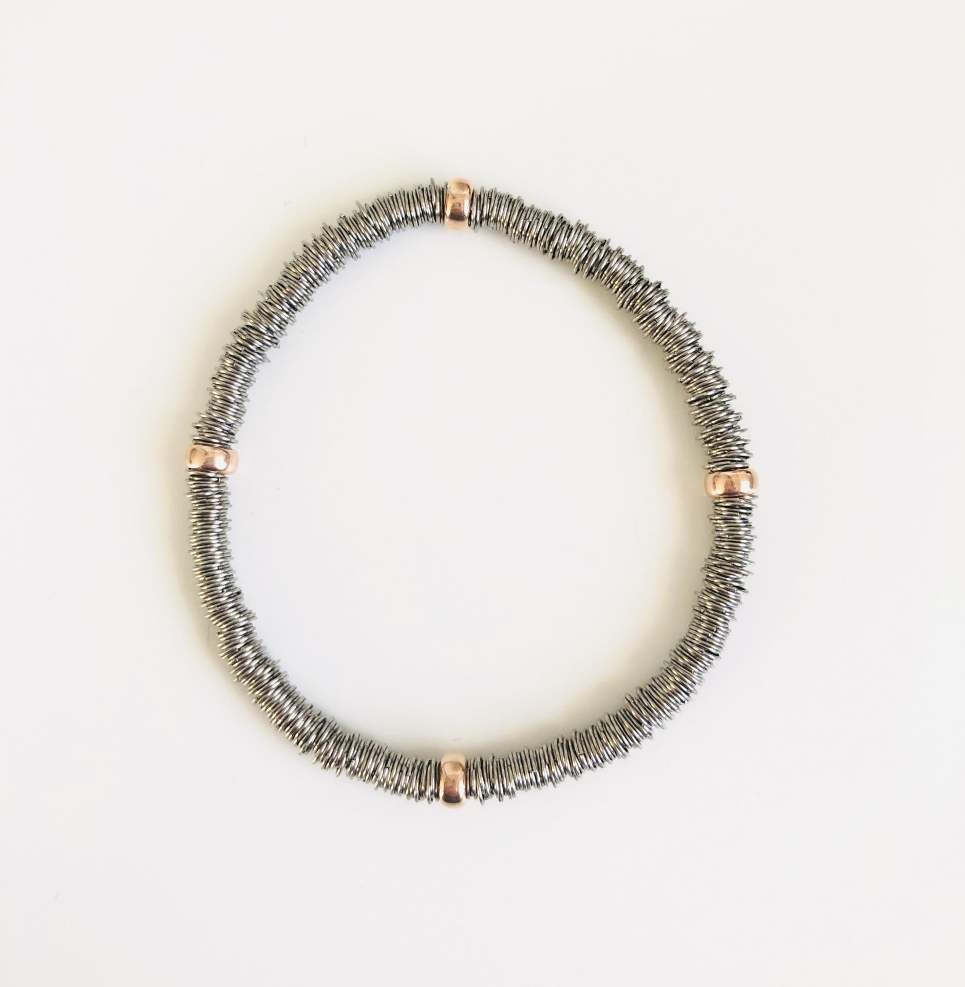 Pulsera  elástica de plata rodiada con bolas bañadas en oro rosa