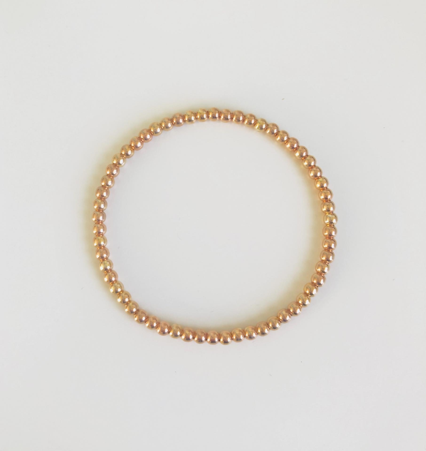 Pulsera elástica de bolas de plata con baño de oro rosa