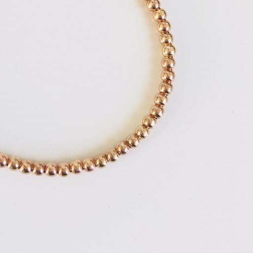 Pulsera elástica de bolas de plata con baño de oro rosa [1]