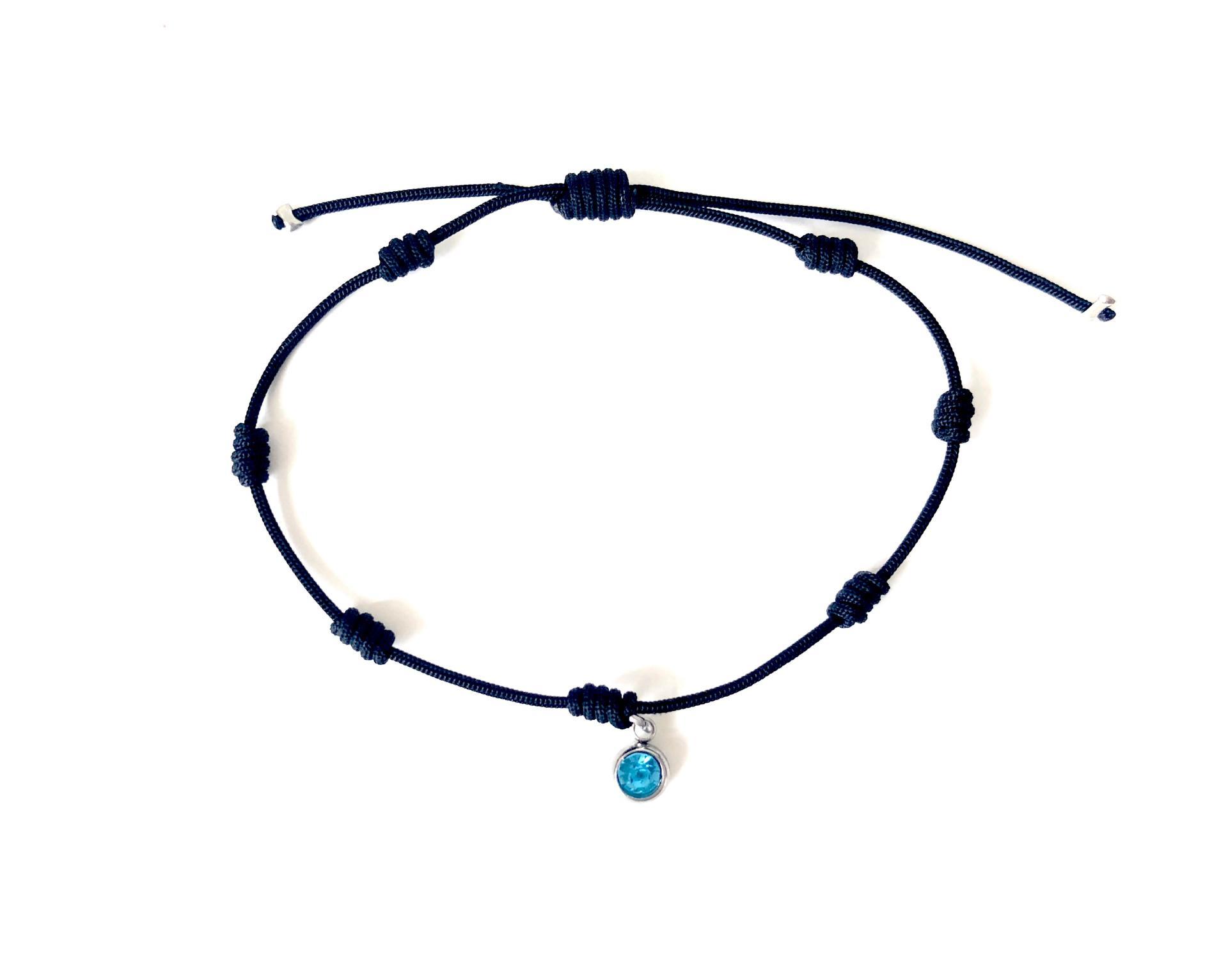 Pulsera negra de 7 nudos con cristal azul turquesa