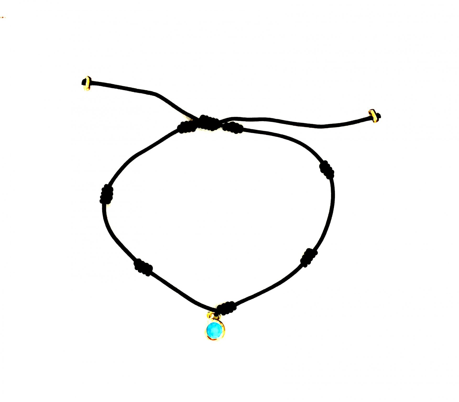 Pulsera negra de 7 nudos  dorada con cristal azul turquesa
