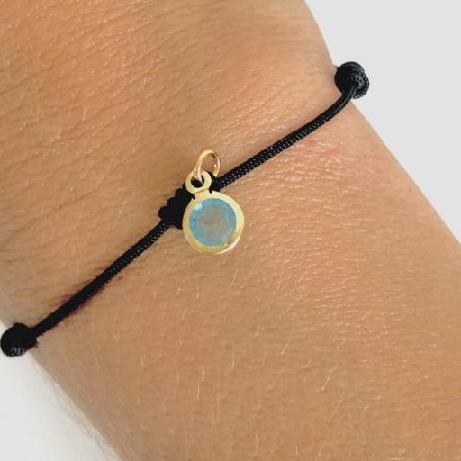 Pulsera negra de 7 nudos  dorada con cristal azul turquesa [1]
