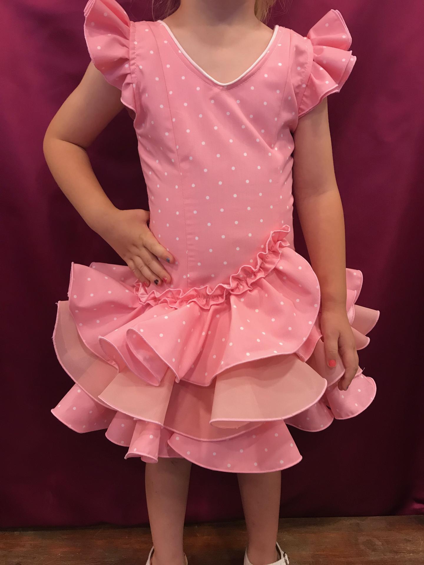 Vestido flamenca niña Fondo rosa lunarillo blanco. Tallas de la 0 a 14.