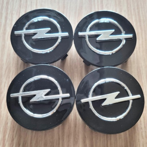 "Tapa Buje  59 * 55 mm.  Rueda  ""Opel"" Color NEGRO  [1]"