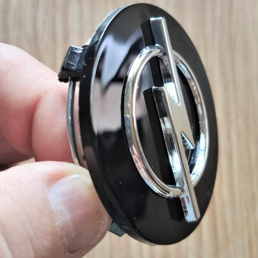 "Tapa Buje  59 * 55 mm.  Rueda  ""Opel"" Color NEGRO  [0]"
