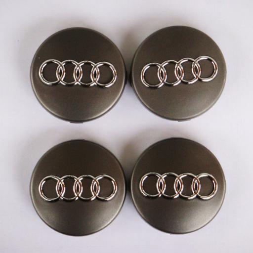 "60 x 56 mm. Tapa Buje Rueda ""Audi""   Color  Gris Oscuro  Diametro: Exterior 60mm. Interior 56mm."""